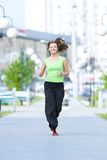 Woman jogging in city street park Royalty Free Stock Photography