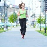Woman jogging in city street park Stock Photos