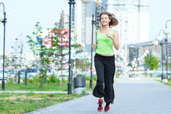 Woman jogging in city street park Royalty Free Stock Photo