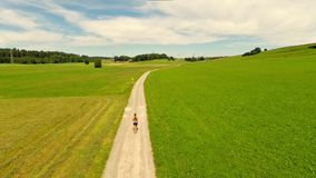 Woman jogging on country road stock footage
