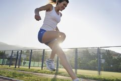 Woman jogging at early morning Stock Image
