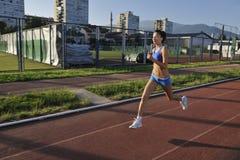 Woman jogging at early morning Royalty Free Stock Photo