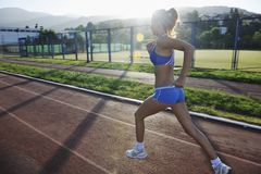 Woman jogging at early morning Stock Image