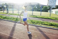 Woman jogging at early morning Stock Images