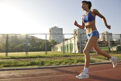 Woman jogging at early morning Royalty Free Stock Photography