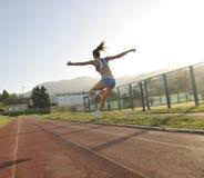 Woman jogging at early morning Stock Photos