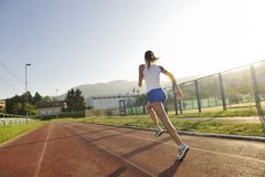 Woman jogging at early morning Royalty Free Stock Photos