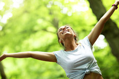 Woman jogging in the forest royalty free stock photos