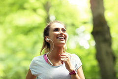 Woman jogging in the forest Stock Images