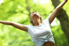Woman jogging in the forest Royalty Free Stock Photography