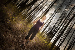 Woman jogging in the forest Royalty Free Stock Images