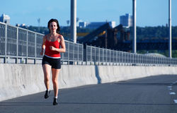 Woman jogging at the highway Stock Images