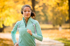 Woman jogging and listening music Stock Image