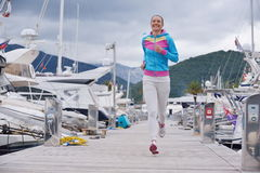 Woman jogging in marina Royalty Free Stock Image