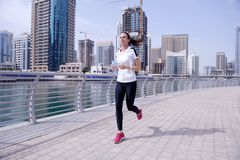 Woman jogging at morning Royalty Free Stock Images