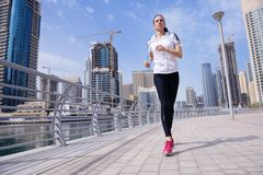 Woman jogging at morning Stock Photos