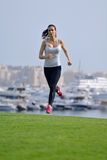 Woman jogging at morning Stock Images