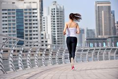 Woman jogging at morning Royalty Free Stock Photos