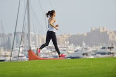 Woman jogging at morning Stock Photo