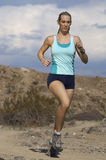 Woman Jogging In Mountains Royalty Free Stock Photos