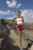 Woman Jogging In Mountains Stock Photo