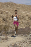 Woman Jogging In Mountains Stock Images