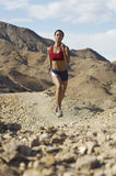 Woman Jogging In Mountains Royalty Free Stock Images
