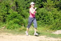 Woman jogging in nature Stock Photo