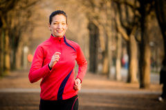 Woman jogging in nature Stock Images