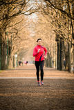 Woman jogging in nature Royalty Free Stock Image