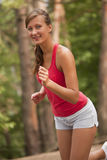 Woman jogging outdoors Stock Images
