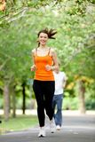 Woman jogging outdoors Stock Photo