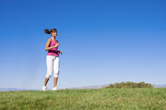 Woman Jogging Outdoors Stock Photos