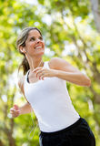 Woman jogging outdoors Royalty Free Stock Photos
