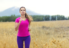 Woman Jogging outdoors Royalty Free Stock Photography