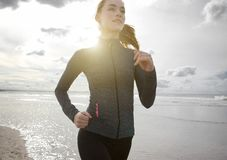 Woman jogging outdoors by the beach Royalty Free Stock Image