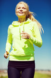 Woman jogging outdoors Royalty Free Stock Image