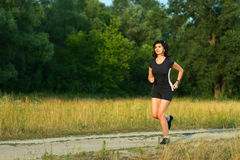 Woman jogging outdoors in forest Royalty Free Stock Photo