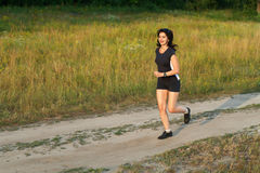 Woman jogging outdoors in forest Royalty Free Stock Photography