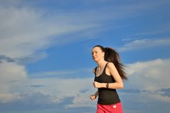 Woman jogging outdoors Royalty Free Stock Photo