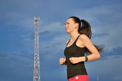 Woman jogging outdoors Stock Image