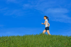 Woman jogging outdoors Royalty Free Stock Images