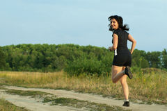 Woman jogging outdoors turn around Royalty Free Stock Images