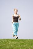 Woman jogging outside Stock Images