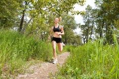 Woman jogging in a park stock photos