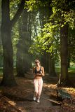 Woman jogging in the park Royalty Free Stock Photo