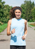 Woman jogging in park Royalty Free Stock Photography