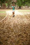Woman jogging in the park . Royalty Free Stock Image