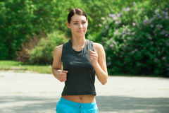 Woman jogging in park Royalty Free Stock Photos