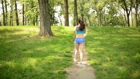 Woman Jogging In The Park stock video footage